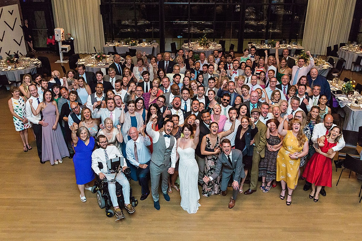 Group shot at the Roundhouse, Beacon NY wedding reception, by Clean Plate Pictures, photojournalist Hudson Valley wedding photographer.